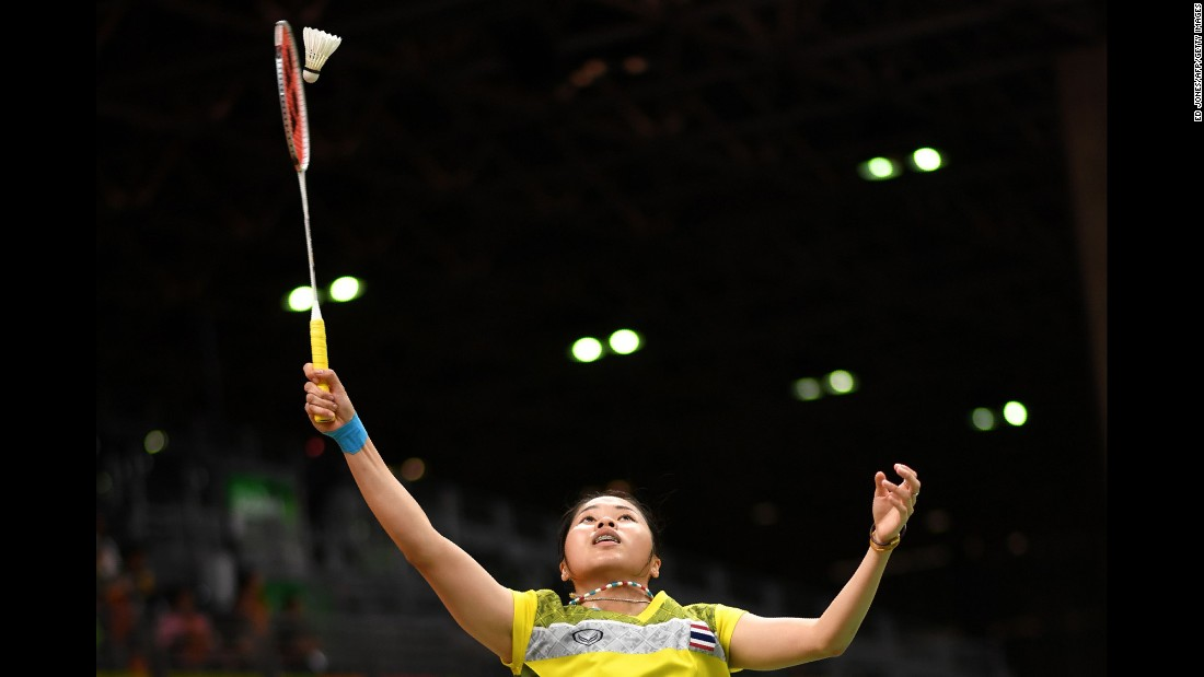 Thailand's Ratchanok Intanon returns the birdie to Hong Kong's Yip Pui Yin during their women's singles qualifying badminton match.
