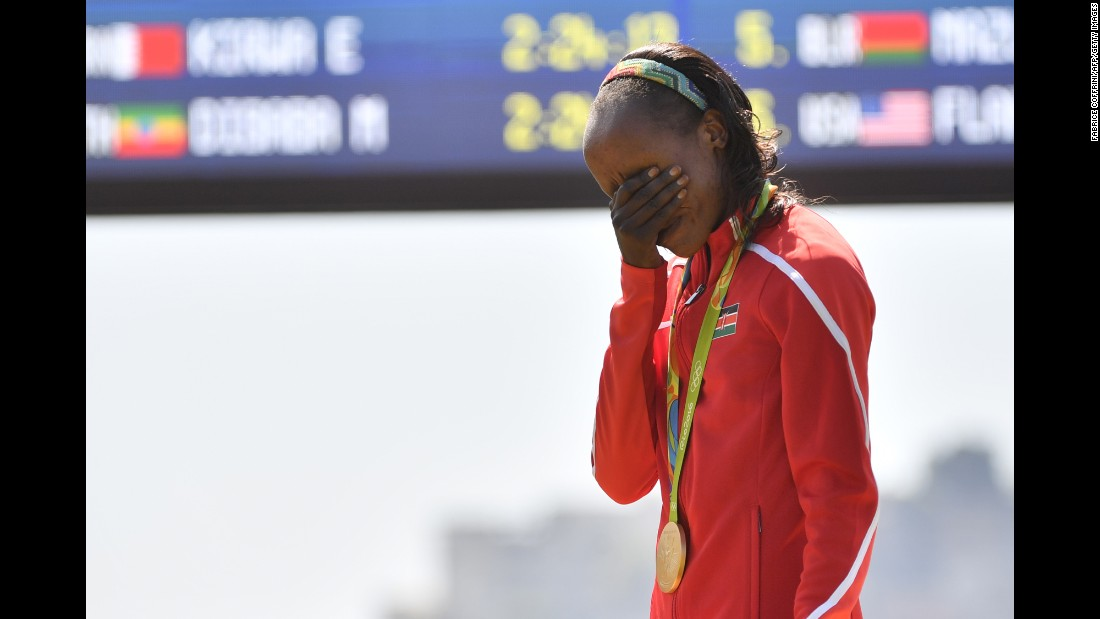 Jemima Sumgong of Kenya becomes emotional during the podium ceremony for the Women's Marathon on Sunday, August 14. Sumgong is the first woman to win a gold medal in Olympic Marathon running for Kenya.