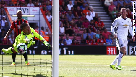 Wayne Rooney  (right) scored his team's second goal with a cleaver header which evaded the Bournemouth goalkeeper.