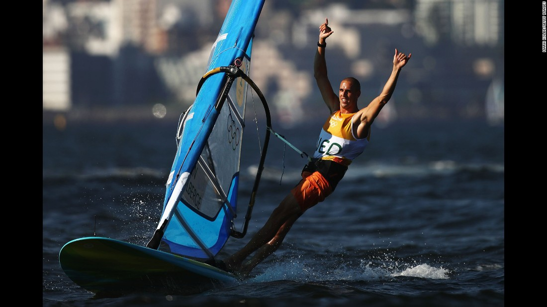 Dorian van Rijsselberghe of the Netherlands celebrates winning the overall Men's RS:X windsurfing class.