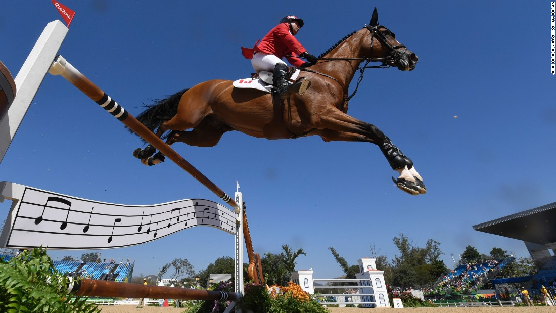Canada's Eric Lamaze on Fine Lady competes during the equestrian's show jumping first qualifier event.