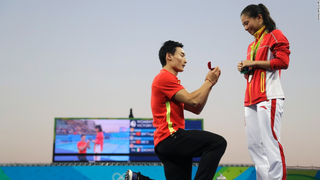 Chinese diver Qin Kai proposes to silver medalist diver He Zhi.