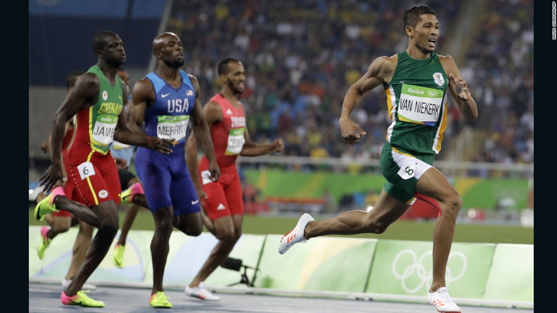 South Africa's Wayde van Niekerk takes the lead in the men's 400-meter final.  He went on to claim the gold and set a new world record.