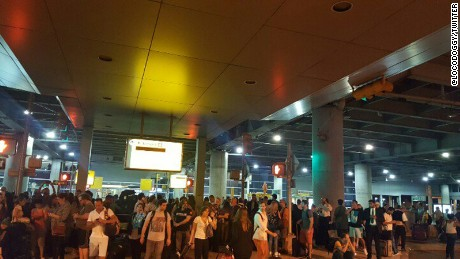 Passengers are evacuated from Terminal 8 at John F. Kennedy International Aiport.