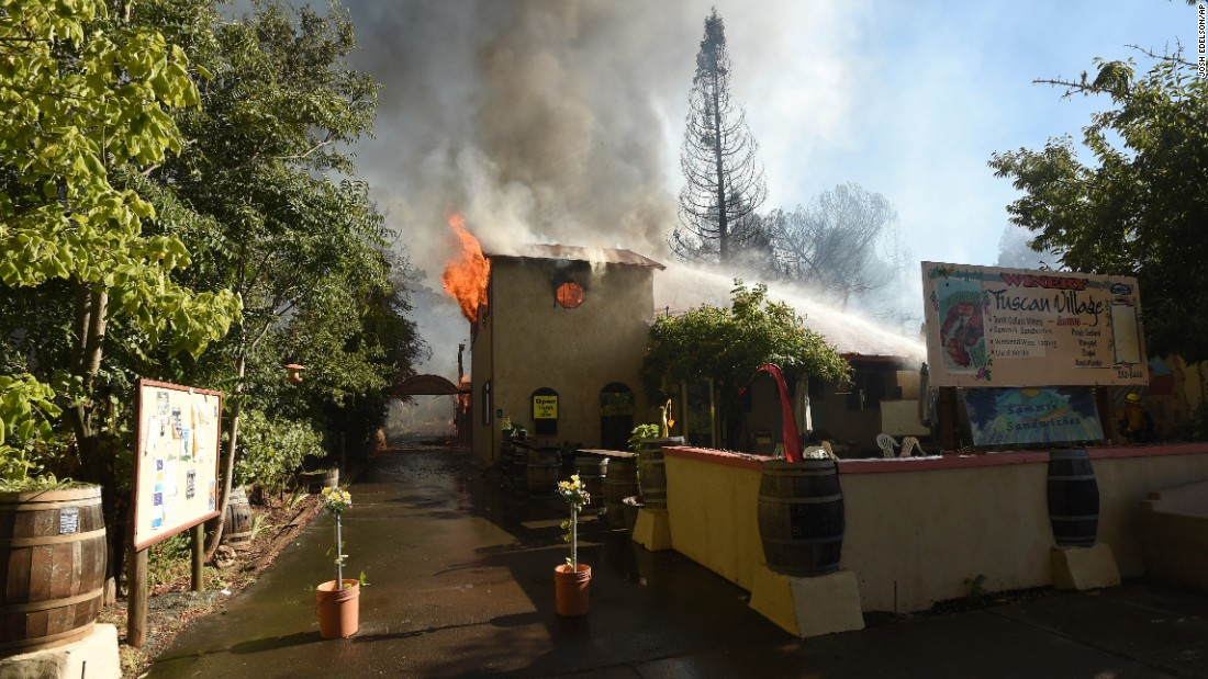 Firefighters work to control flames at the Terrill Cellars Winery  in the town of Lower Lake, California.