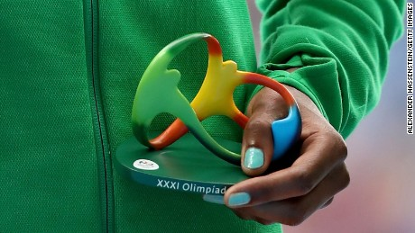 The figurine, as held by gold medalist Almaz Ayana of Ethiopia.