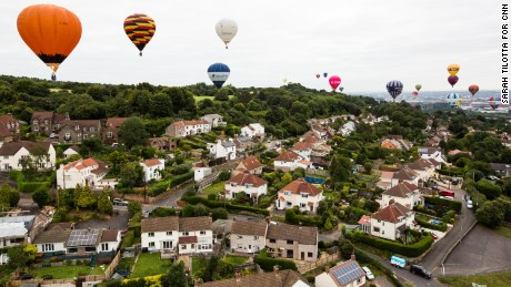 An armada of balloons drifts over Long Ashton, near the fiesta site.