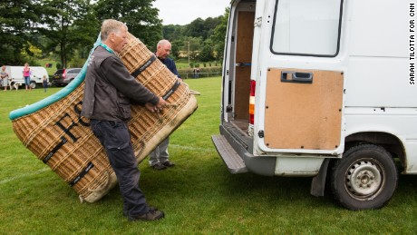 "David Bareford, left, and John Coleman load the Fortnum & Mason basket into a van, before returning to Ashton Court Sunday. Over the course of his balloon piloting days in Kenya, Coleman says he flew 38,000 passengers, including Al Gore. ""I always say about ballooning, we're in the happiness and memory business."""