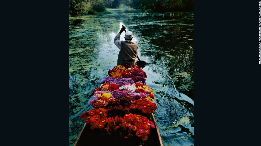 Flower Seller at Dal Lake by Steve McCurry