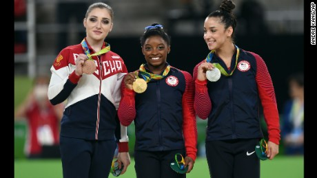 Aliya Mustafina, Simone Biles, and Alexandra Raisman on the medal stand at the 2016 Rio Olympics.