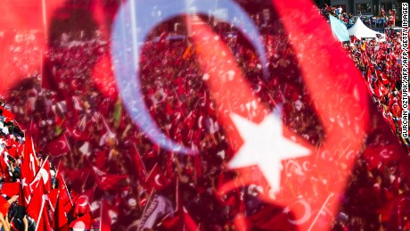 People wave Turkish flags during a rally organised by the main opposition group, the secular and centre-left Republican People's Party (CHO), on July 24, 2016 in Istanbul's Taksim square.