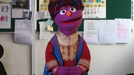 On the Afghan Sesame Street, Zari counts in Dari and sings.