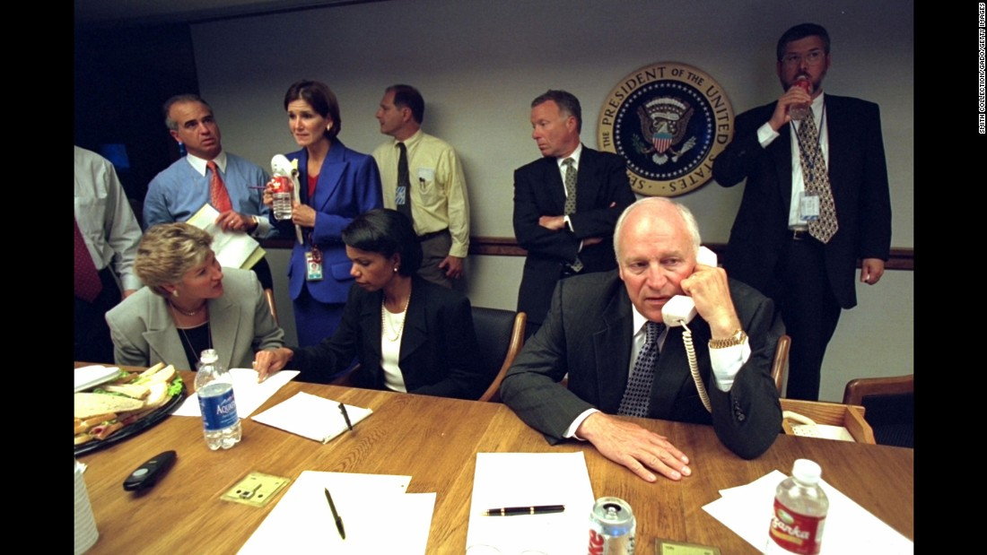 U.S. Vice President Dick Cheney talks on the phone from inside the President's Emergency Operations Center.