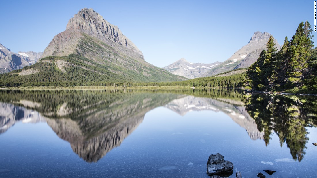 "The avid <a href=""http://johnmcgrawphotography.com/"" target=""_blank"">travel photographer</a> stopped for many photo opportunities throughout the park, like Swiftcurrent Lake (above), Highline Trail and Grinnell Glacier."