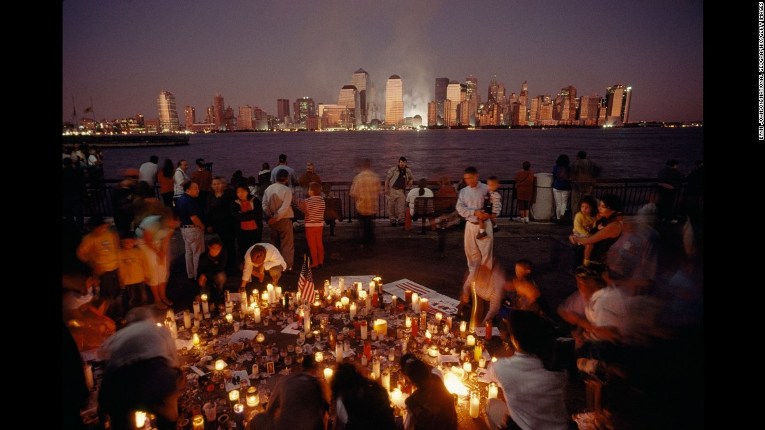 People in New York gather for a candlelight vigil a day after the attacks.