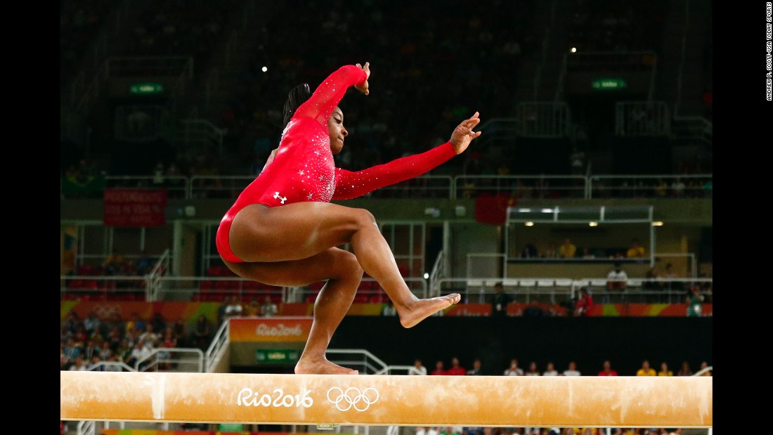 U.S. gymnast Simone Biles, who had already won the individual all-around and the vault, wobbles during the balance beam finals on Monday, August 15. She finished with the bronze.