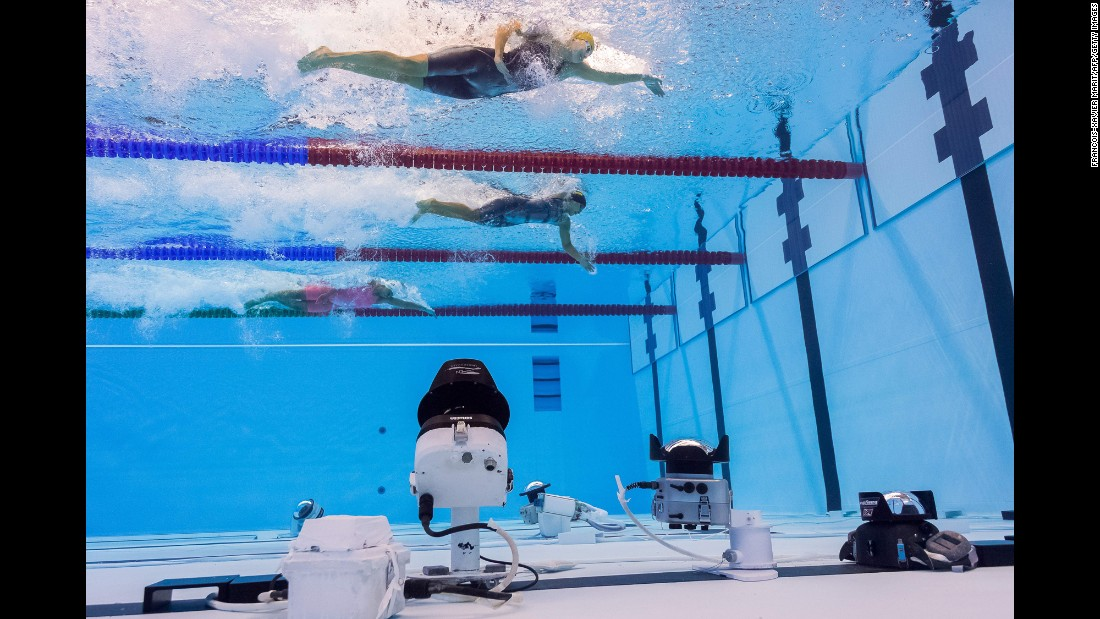 "Cameras are set up at the bottom of the swimming pool as women take part in a 50-meter freestyle heat on Friday, August 12. <a href=""http://www.cnn.com/2016/08/11/sport/cnnphotos-al-bello-olympics/"" target=""_blank"">Catching the Olympic moments that TV doesn't</a>"