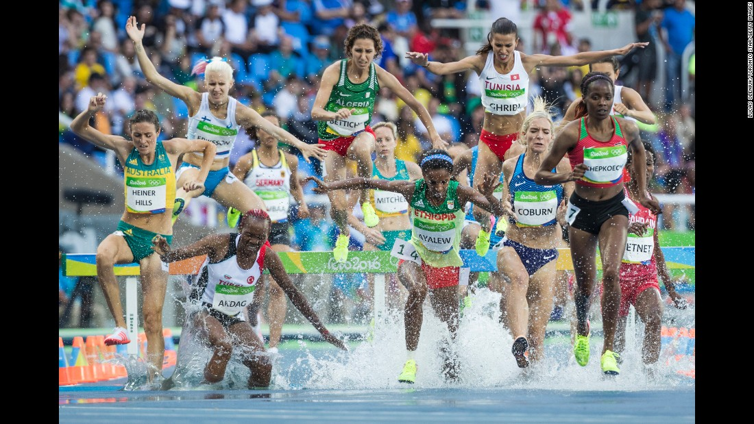 Athletes race in the semifinals of the 3,000-meter steeplechase on Sunday, August 14.