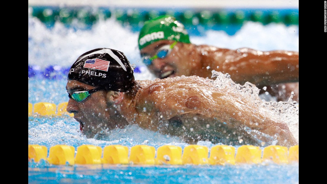 "South Africa's Chad Le Clos, right, looks over at Michael Phelps during <a href=""http://www.cnn.com/2016/08/09/sport/michael-phelps-katie-ledecky-swimming/index.html"" target=""_blank"">the 200-meter butterfly final</a> on Tuesday, August 9. Phelps' victory avenged one of the few losses of his Olympic career -- a second-place finish to Le Clos in 2012."