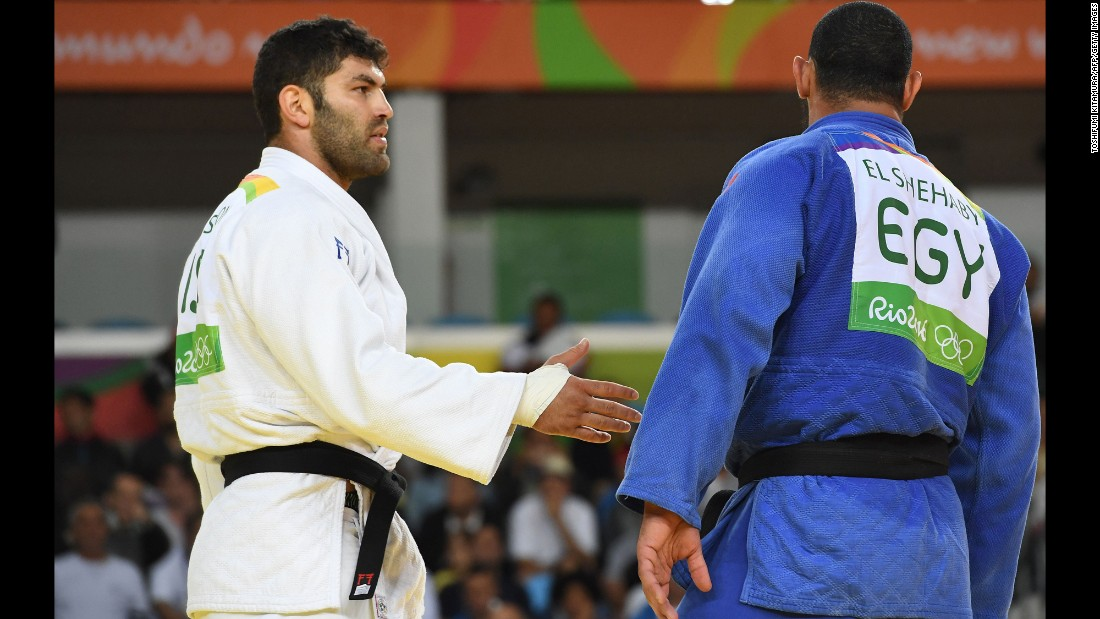 "Israel's Or Sasson offers a handshake to Egypt's Islam El Shehaby after their judo match on Friday, August 12. El Shehaby refused and <a href=""http://www.bbc.com/sport/olympics/37090339"" target=""_blank"">was later sent home</a> by the Egyptian Olympic Committee."
