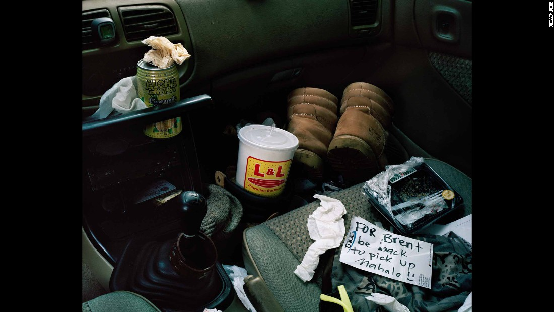 "The inside of one Hawaiian's car. ""I don't know this individual well, but it looks to me like he works pretty hard,"" Jung said. ""He's got his boots in his car. You can tell he's got his L&L Hawaiian Barbecue (a famous local fast-food chain) and his can of Aloha Maid soda (a classic local beverage). He's got to eat in his car to get his lunch before he goes to his next job."""