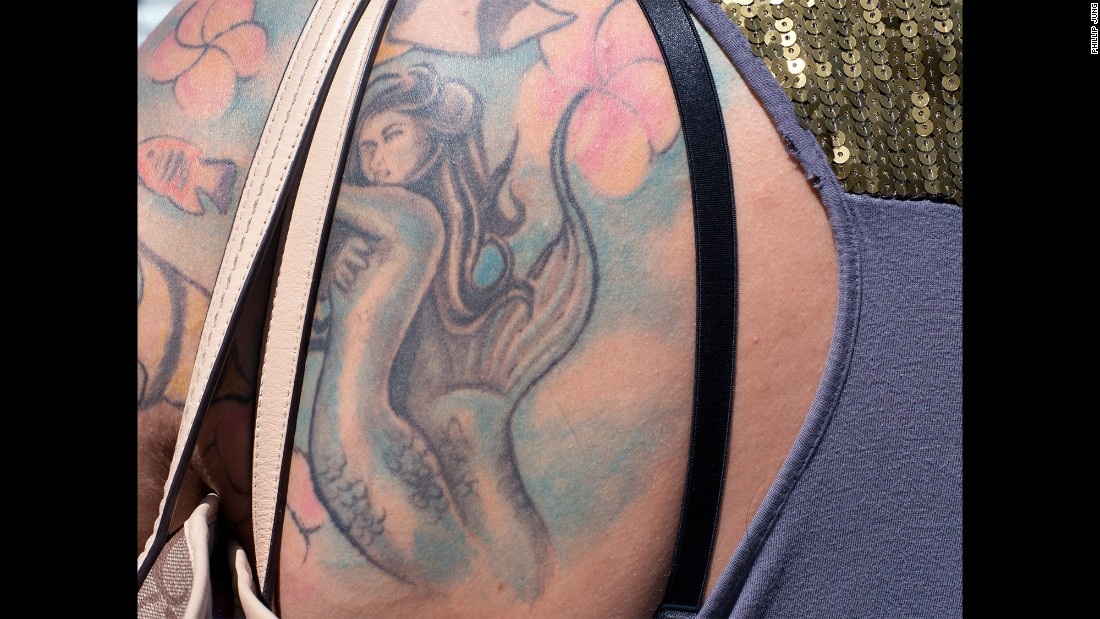 A close-up of a mermaid tattoo.