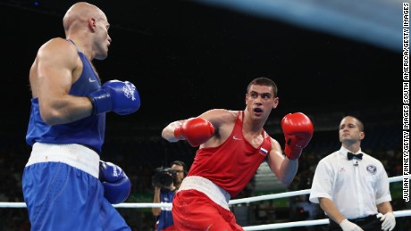 Evgeny Tishchenko (red) faced Kazakhstan's Vassiliy Levit in the heavyweight final at Rio 2016.