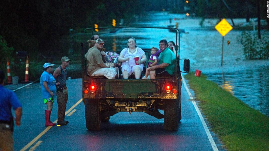 Emergency personnel rescue flood victims near Walker on August 14.