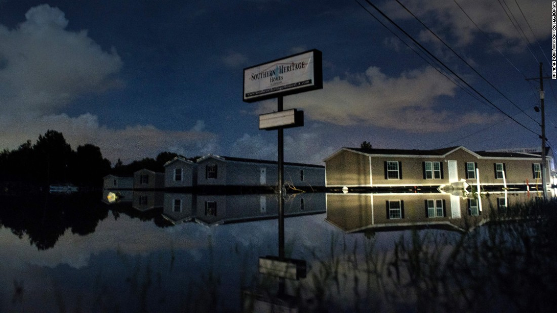 Floodwaters surround prefabricated houses in Denham Springs on August 15.