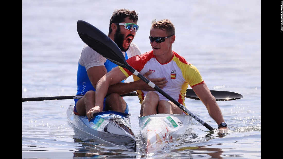 Canoeist Josef Dostal of the Czech Republic, left, celebrates with Spain's Marcus Walz after the K-1 1,000-meter final. Walz and Dostal took gold and silver while Russia's Roman Anoshkin earned the bronze.