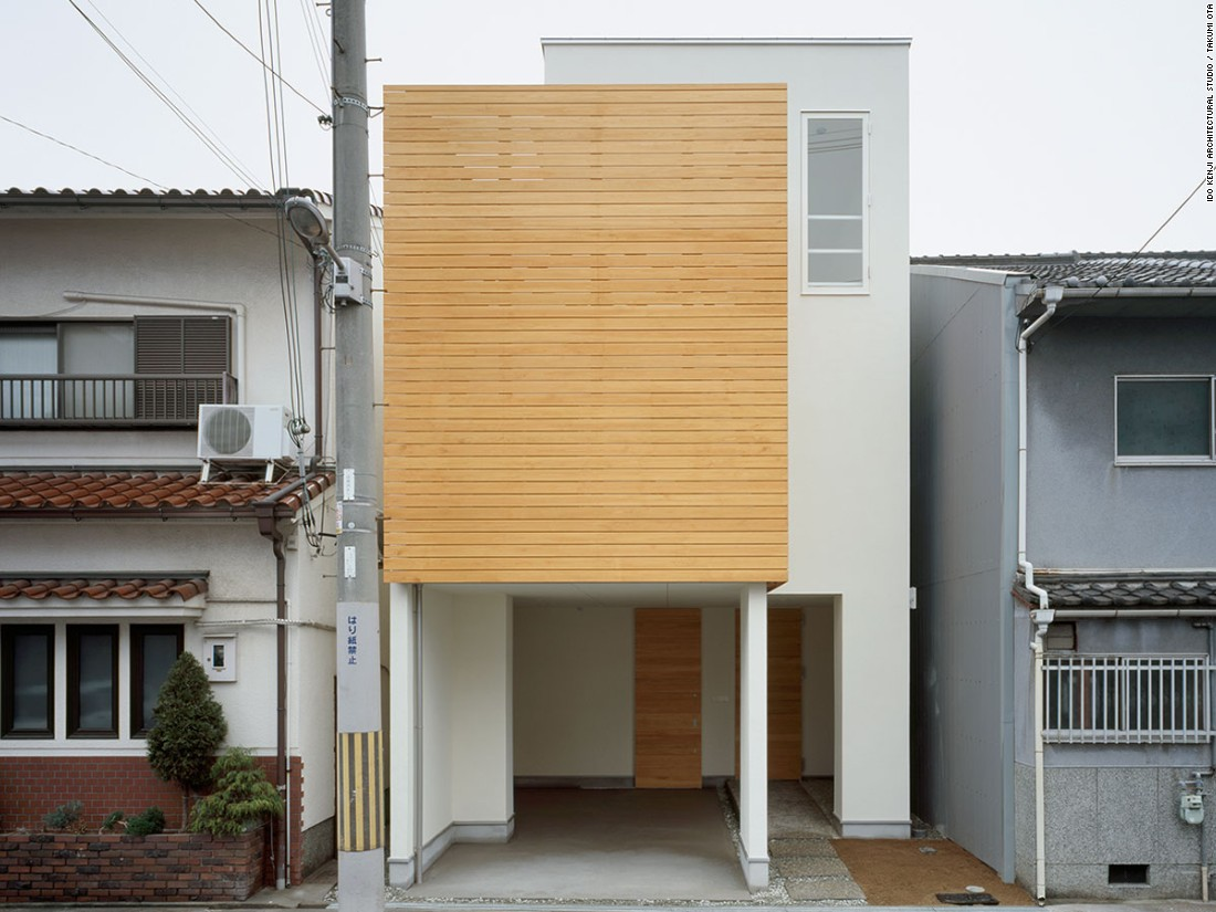 Designed by Ido Kenji Architectural Studio, House F was built on a narrow plot of land for a couple in Osaka. The three-story house incorporates warm pine wood, large windows, and a garden on the south side.