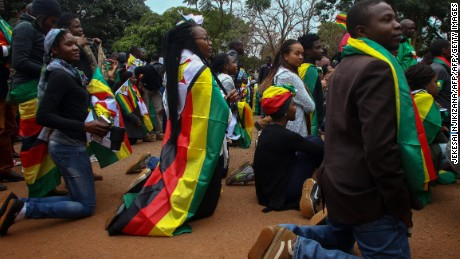 Supporters of the ThisFlag campaign kneel outside the Harare magistrate's court where pastor Evan Mawarire appeared on July 13.