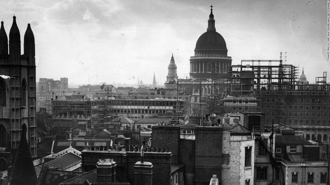 London's skyline was irrevocably altered by bombing in the Second World War. Many of the remaining historical buildings became protected -- but whole areas were wiped out and needed to be rebuilt. This image depicts St Paul's post-war reconstruction being carried out in London after the war.