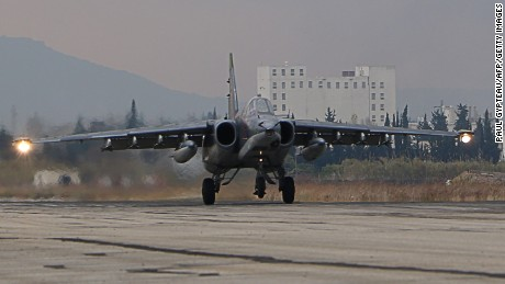 A Russian Sukhoi Su-34 bomber lands at the Russian Hmeimim military base in Latakia province, in the northwest of Syria, on December 16, 2015.