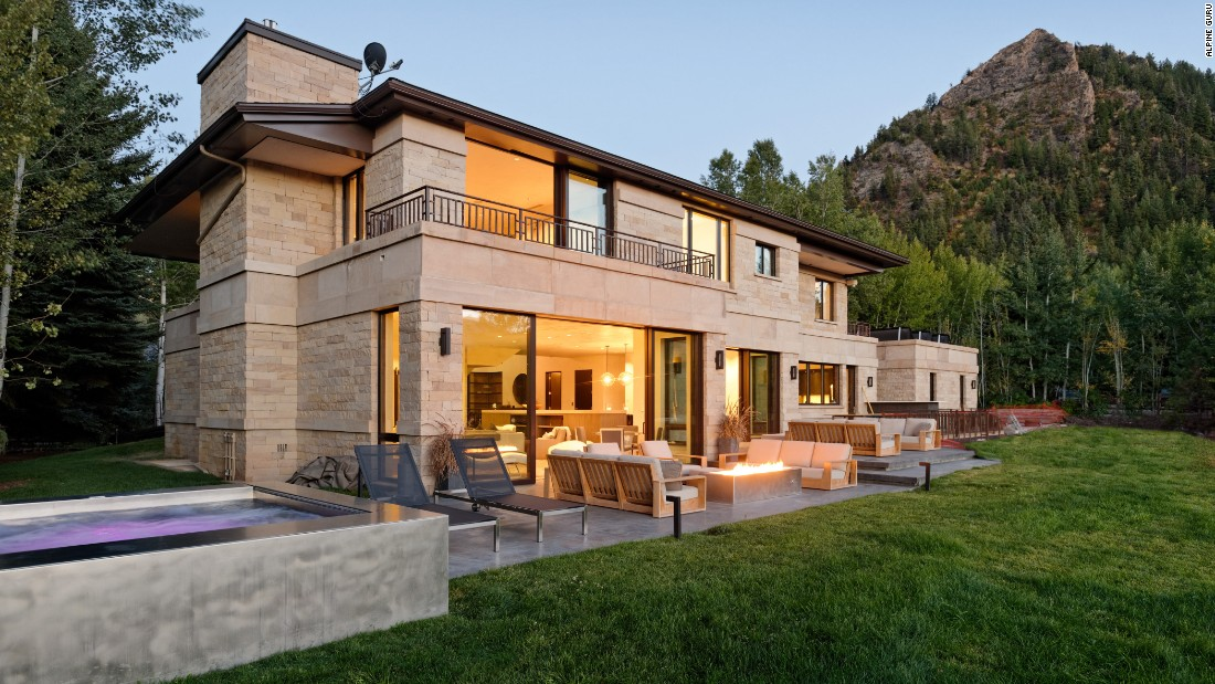 Luxury vacation rental Castle Rim in Aspen, Colorado, features six bedrooms and a private terrace with a huge hot tub, fire pit and al fresco dining.