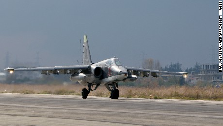 A Russian Su-25 bomber lands at a base in Latakia province, in northwest Syria on December 16, 2015.