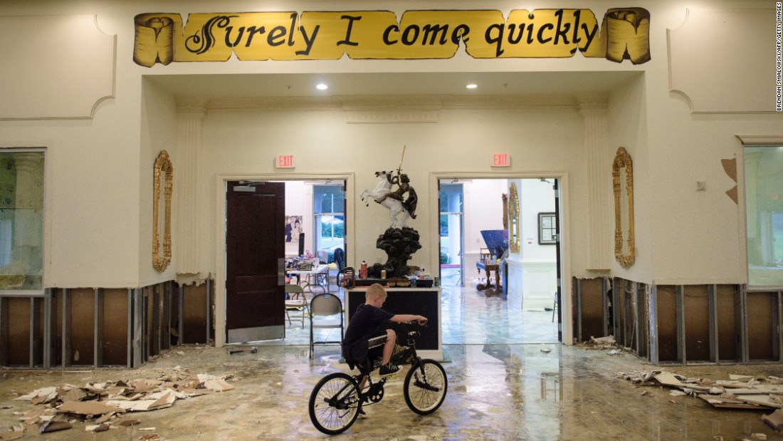 A boy in Baton Rouge rides his bike inside the flood-damaged Life Tabernacle Church on August 15.