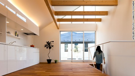 Inside Atelier Tekuto's M House, everything has its place. The uncluttered space feels spacious and large, an effect that's accentuated by floor-to-ceiling windows.