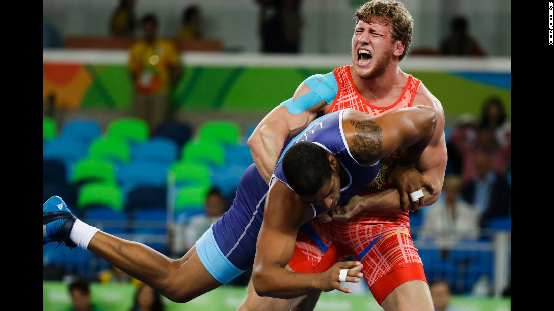 Armenian wrestler Artur Aleksanyan, in red, competes against Cuba's Yasmany Daniel Lugo Cabrera in a Greco-Roman final. Aleksanyan came out on top.