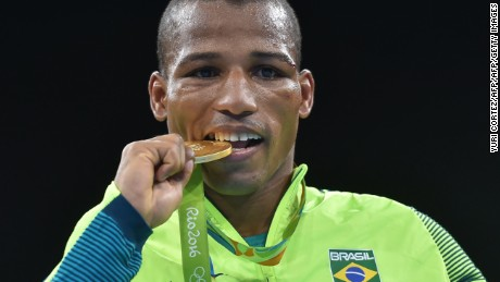 Brazil's Robson Conceicao poses with a gold medal at the Rio 2016 Olympic Games in Rio de Janeiro on August 16, 2016.