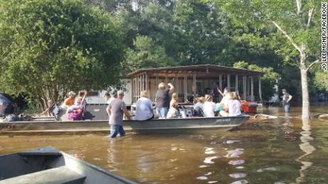 Residents grapple with epic flooding in Livingston Parish, Louisiana.