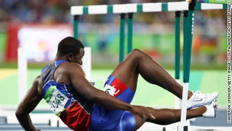 Jeffrey Julmis doesn't get enough height on his first jump and crashes straight into the first hurdle of the men's 110m hurdles semifinals of the Rio Olympics.