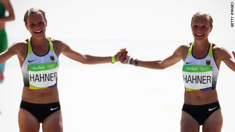Olympic twins finish race holding hands