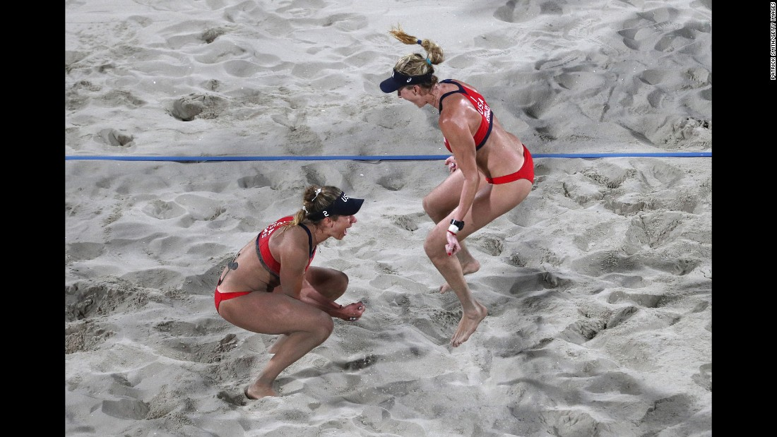 U.S. beach volleyball players April Ross, left, and Kerri Walsh Jennings celebrate their bronze-medal win over Brazil's Larissa Franca and Talita Antunes.