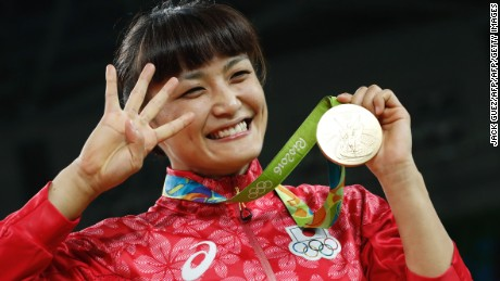 Japan's Kaori Icho celebrates on the podium after winning after winning in the women's 58kg freestyle wrestling event at the Carioca Arena 2 in Rio de Janeiro on August 17, 2016, during the Rio 2016 Olympic Games. / AFP / Jack GUEZ        (Photo credit should read JACK GUEZ/AFP/Getty Images)