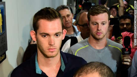 American swimmers Gunnar Bentz (L) and Jack Conger leave the police station at the Rio de Janeiro International Airport after being detained on the plane that would travel back to the US.   Brazilian police arrested two US swimmers and a top International Olympic Committee official as scandal overshadowed the Rio Games and Usain Bolt's progress toward a new gold.  Jack Conger and Gunnar Bentz were taken off a flight leaving Rio de Janeiro by authorities investigating doubts over their claim to have been mugged. / AFP / TASSO MARCELO        (Photo credit should read TASSO MARCELO/AFP/Getty Images)