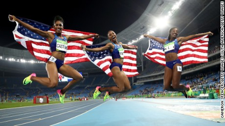 The US trio celebrated after their stunning hurdles success.