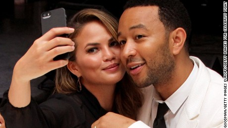 FLORENCE, ITALY - SEPTEMBER 05:  Chrissy Teigen and John Legend attend the White Party Dinner Hosted by Andrea and Veronica Bocelli Celebrating Celebrity Fight Night In Italy Benefitting The Andrea Bocelli Foundation and The Muhammad Ali Parkinson Center on September 5, 2014 at the Bocelli Residence in Forte dei Marme, Italy.  (Photo by Andrew Goodman/Getty Images for Celebrity Fight Night)
