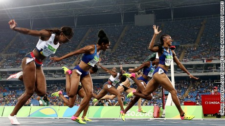 Brianna Rollins of the United States (R) wins the gold medal in the Women's 100m Hurdles Final in front of many empty seats.