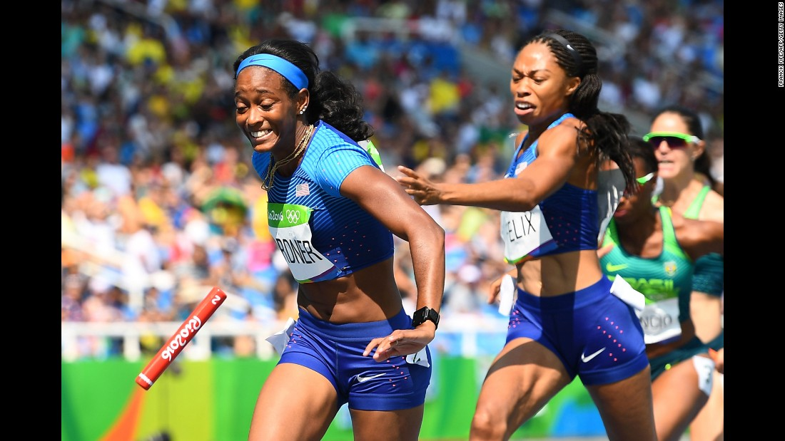 American Allyson Felix tries to hand the baton to teammate English Gardner in a 4x100-meter relay heat. The U.S. team was disqualified after dropping the baton, but it won an appeal after officials ruled the pair had been obstructed by a Brazilian runner during the exchange. They later clinched a spot in the final after a re-run.